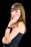 Recht junge blonde Stellung mit der Hand oben Stockbild