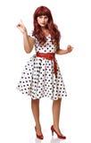 Recht junge Frau in einer Perücke und in einem Kostüm lizenzfreie stockfotografie