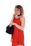Recht junge Frau im roten Kleid Stockfotos