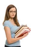 Recht junge Frau mit Büchern stockfotos
