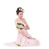 Recht junge Frau mit Tulpen Stockbilder