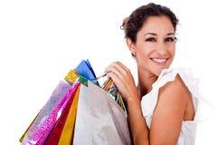 Recht junge Frauen, die mit Einkaufstasche lächeln Lizenzfreies Stockbild