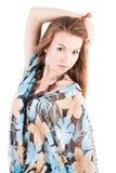 Recht junges Mädchen in einem hellen Kleid stockfotografie