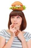 Recht junges Mädchen mit Hamburger Stockbild