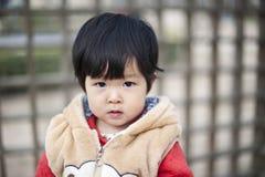 Recht kleines chinesisches Mädchen Lizenzfreies Stockfoto