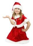 Recht kleines Mädchen in Weihnachtsmann-Kostüm auf dem weißen backgrou Lizenzfreies Stockbild