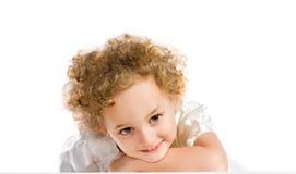 Recht lockiges blondes kleines Mädchen Stockbilder