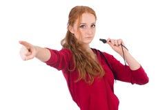 Recht weibliche Sportlerholdingpfeife lokalisiert stockfoto