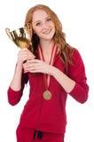 Recht weiblicher Sportler mit dem Preis an lokalisiert stockfoto