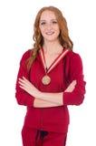 Recht weiblicher Sportler mit der Medaille an lokalisiert lizenzfreies stockbild