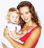 Recht wirkliche Modemutter mit nettem blondem kleinem Tochterabschluß oben lokalisiert auf weißem Hintergrund, Lebensstilleute Stockbilder