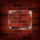 Rechteckiger Glasrahmen auf Ziegelsteinhintergrund Stockfotos
