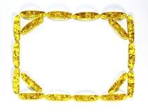 Rechteckiger Rahmen von bernsteinfarbigen Steinen Lizenzfreies Stockbild