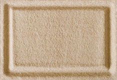 Rechteckrahmenimpressum im Sandoberflächenmakrofoto Lizenzfreies Stockfoto