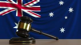 Rechters` s hamer en blok tegen de vlag van Australië Het Australische hof conceptuele 3D teruggeven Stock Fotografie