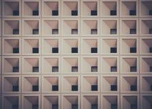 Rechthoekig patroon van de ruimte op de muur de bouwachtergrond Stock Foto