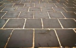 Rechthoekige steen natte textuur als achtergrond Stock Afbeelding