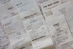 Recibos de las compras para los minoristas en Inglaterra foto de archivo libre de regalías