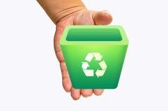Recicl o escaninho na mão Imagem de Stock
