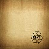 Recicle el símbolo en textura de la cartulina Foto de archivo