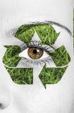 Recicle o sinal pintado na cara, conceito do eco Imagem de Stock Royalty Free
