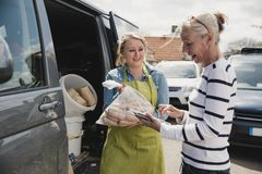 Recieving a Delivery of Sausages stock photo