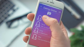 Recieving new message on dating app on the smartphone stock footage