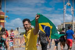 Fans of Brazil during the 2018 FIFA World Cup Russia. Recife, Pernambuco, Brazil - June 22, 2018: Fans of Brazil watching the match between the 2018 FIFA World Stock Image