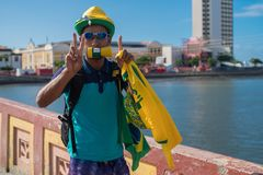 Fans of Brazil during the 2018 FIFA World Cup Russia. Recife, Pernambuco, Brazil - June 22, 2018: Fans of Brazil watching the match between the 2018 FIFA World Stock Photos