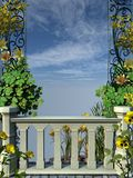 Recinto di pietra con i fiori gialli Fotografia Stock