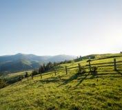 Recinto sulle colline della montagna Fotografia Stock