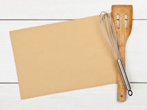 Recipe background. Empty paper for recipe with cooking utensils on kitchen table Royalty Free Stock Photos