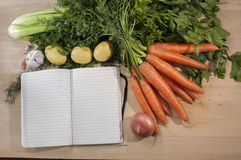 Recipe block note with vegetables Stock Photo