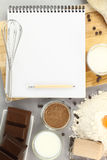 Recipe book. With chocolate and other ingredients Royalty Free Stock Photography