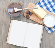 Recipe book. Blank recipe book surrounded with ingredients including hot chocolate Stock Image