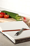 Recipe book. On the table in the kitchen Stock Images
