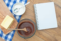 Recipe book. Blank recipe book surrounded with ingredients including hot chocolate Royalty Free Stock Image