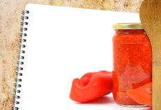 Recipe book. Blank recipe book on grunge background with pepper salad Royalty Free Stock Photo