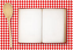 Recipe book on checkered tablecloth Royalty Free Stock Photo