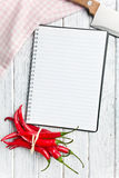 Recipe book with chili peppers Royalty Free Stock Photos