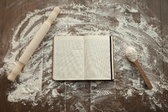 Recipe book on floured table. Stock Images