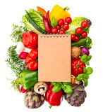 Recipe book with fresh vegetables and herbs. healthy food ingred Royalty Free Stock Image