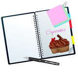 Recipe book illustrated with choco and cherry cupcakes. Recipe book illustrated with cupcakes isolated on white Stock Photography