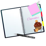 Recipe book illustrated with cookie-choco cupcake. Isolated on white Royalty Free Stock Photography