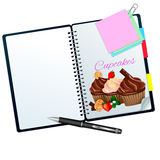 Recipe book illustrated with cupcakes Royalty Free Stock Image