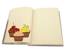 Recipe book illustrated with cupcakes Royalty Free Stock Photography