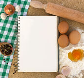 Recipe book with ingredients Royalty Free Stock Photography