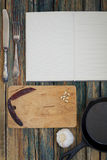 Recipe book with a mix of kitchen objects on a vintage wood back Stock Photography