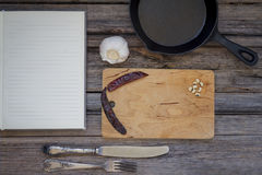 Recipe book with a mix of kitchen objects on a vintage wood back Royalty Free Stock Photography