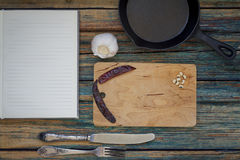 Recipe book with a mix of kitchen objects on a vintage wood back Royalty Free Stock Images